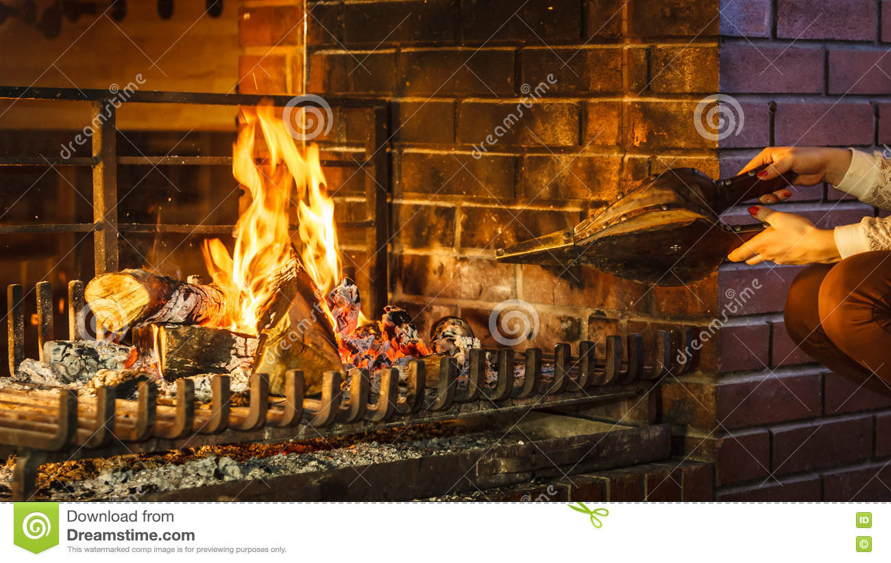 Closeup Hands Fireplace Making Fire With Bellows Stock Photo