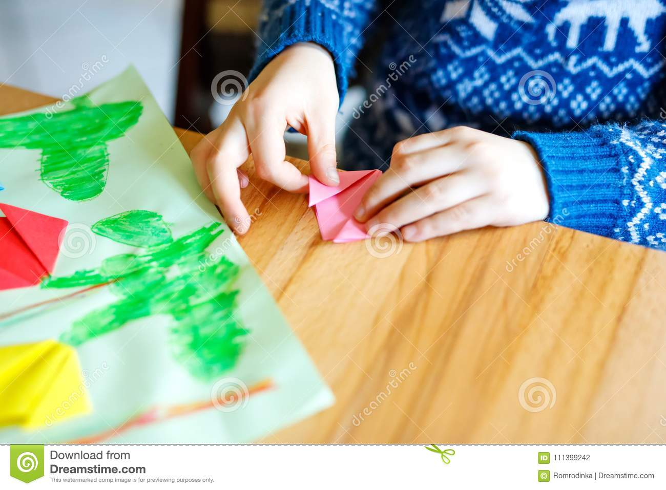 Closeup Of Hands Of Little Kid Making Tulip Flowers Origami For A