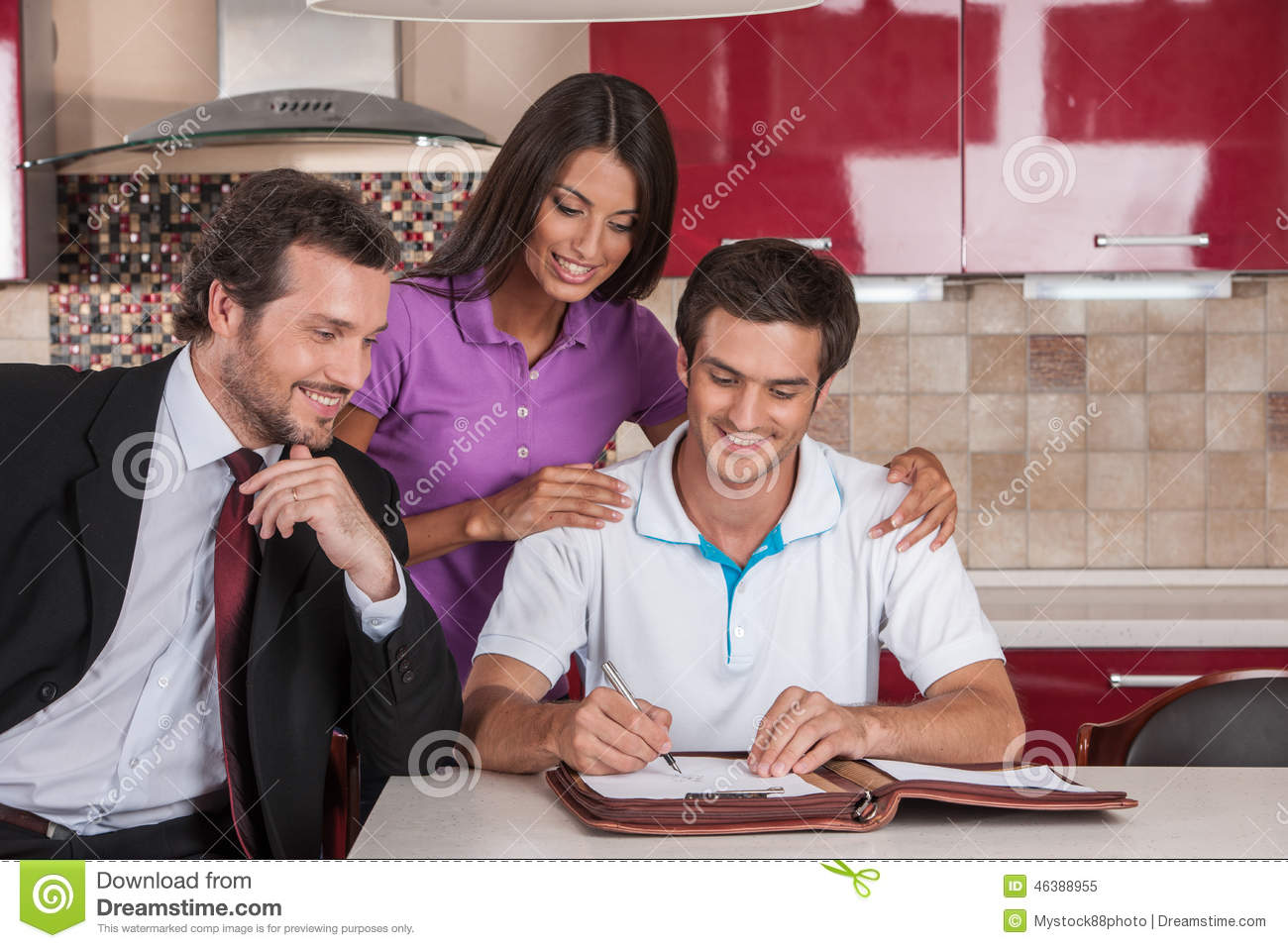 Closeup on happy man signing agreement on new house.