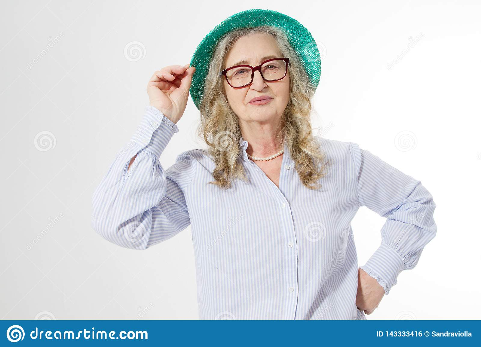 Closeup of happy stylish senior woman in business glasses and summer hat . Positive life living of elderly people. Healthy