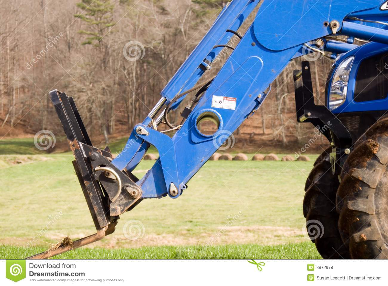 Closeup/ haylifter on tractor