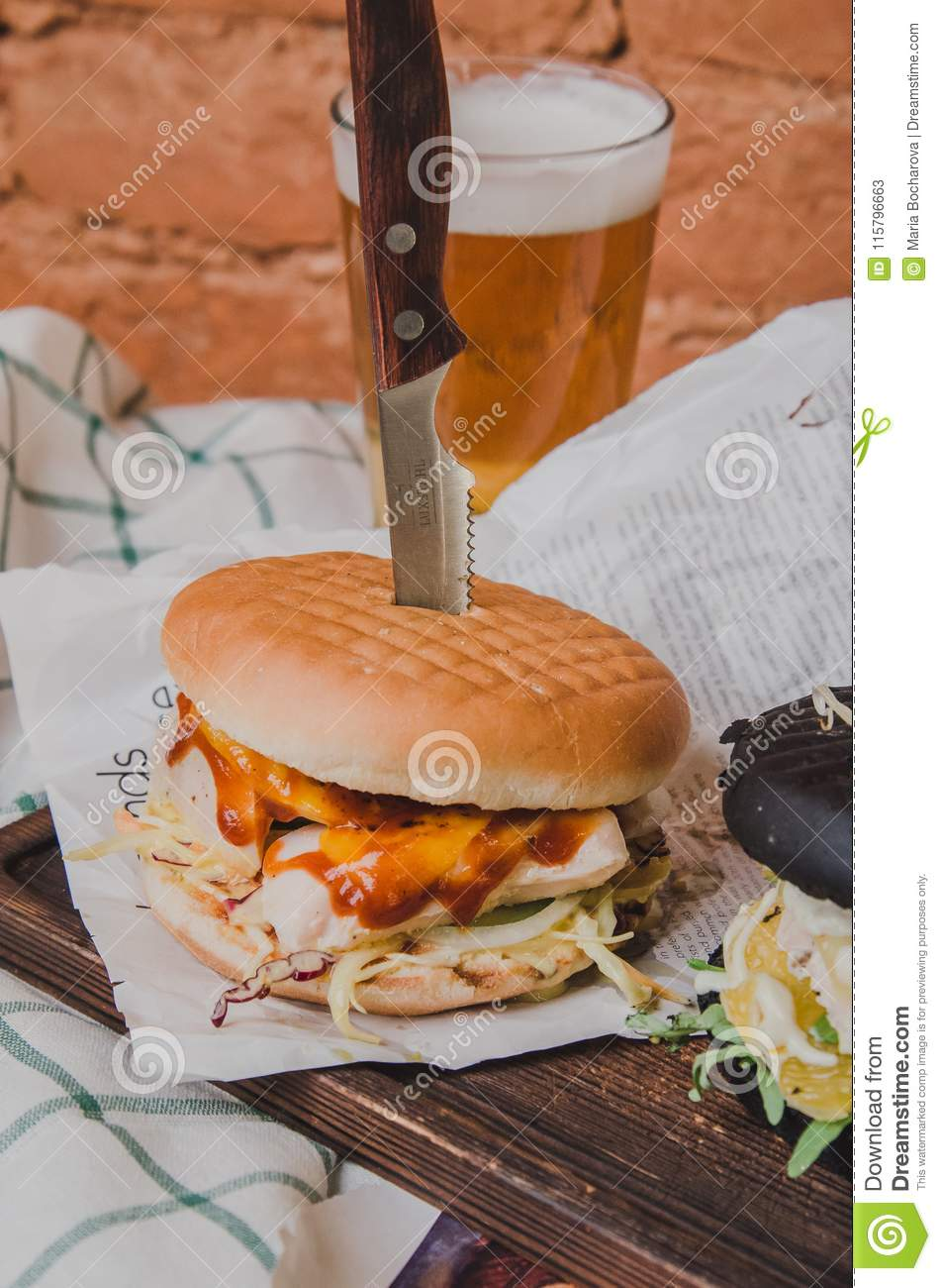 Closeup Of Home Made Burger With Chicken, Tomato Sauce