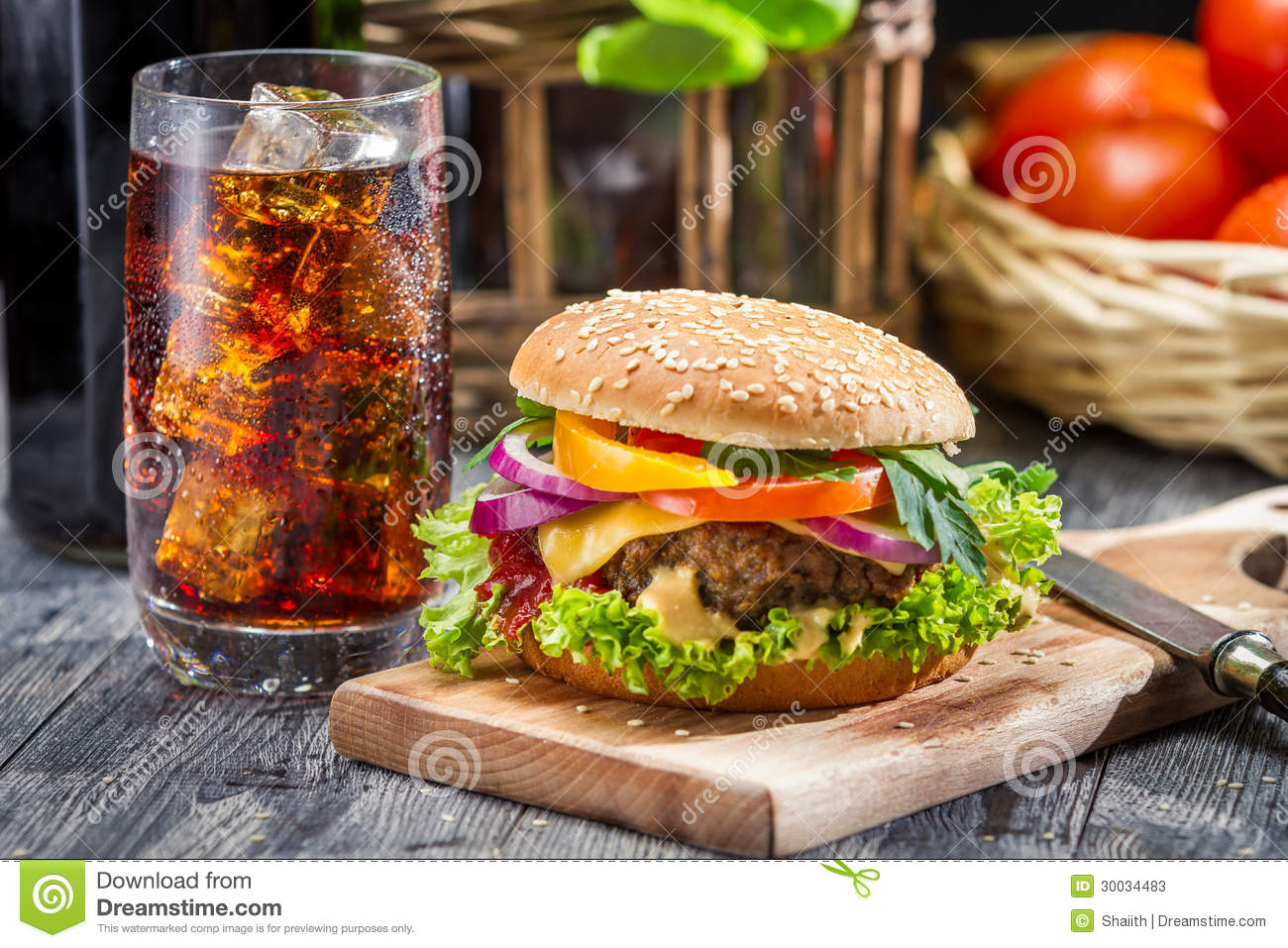 Closeup Of Homemade Hamburger And A Coke With Ice Stock