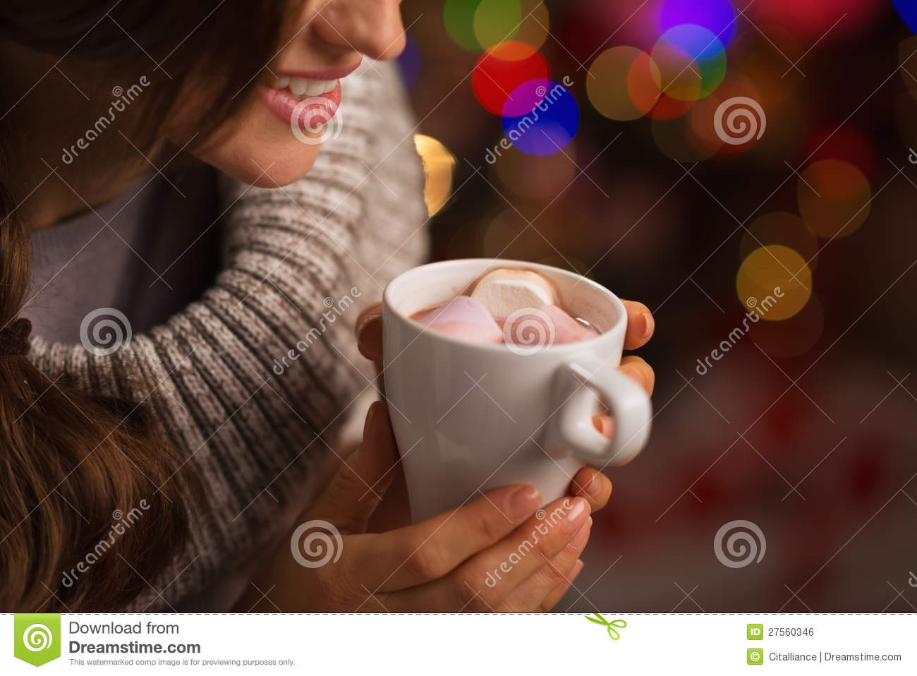 Closeup on hot chocolate in hand of woman
