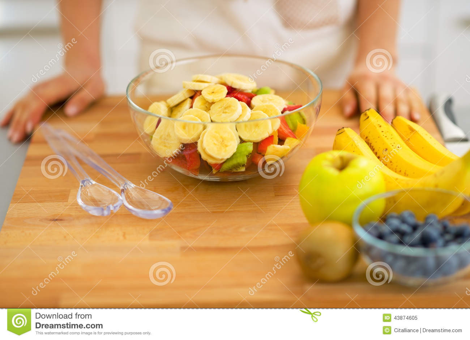 Closeup on housewife making fresh fruit salad