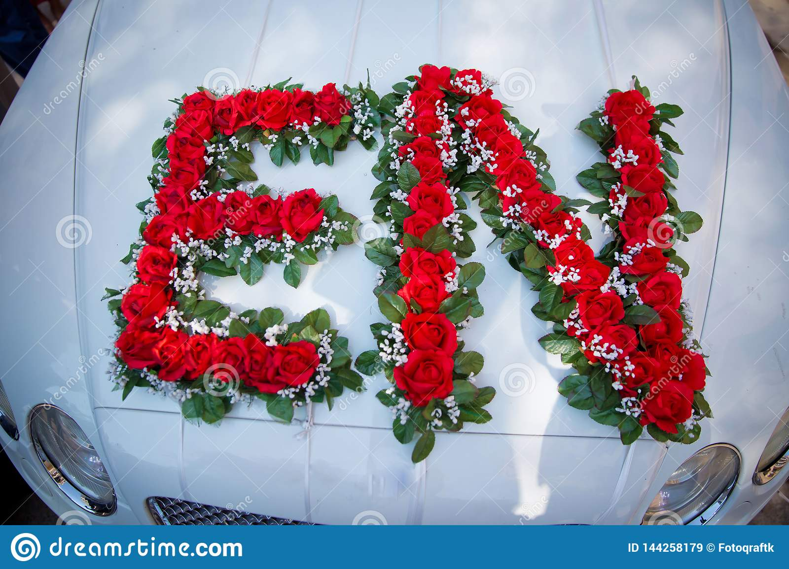 Closeup Image Of Wedding Car Decoration With Red And White
