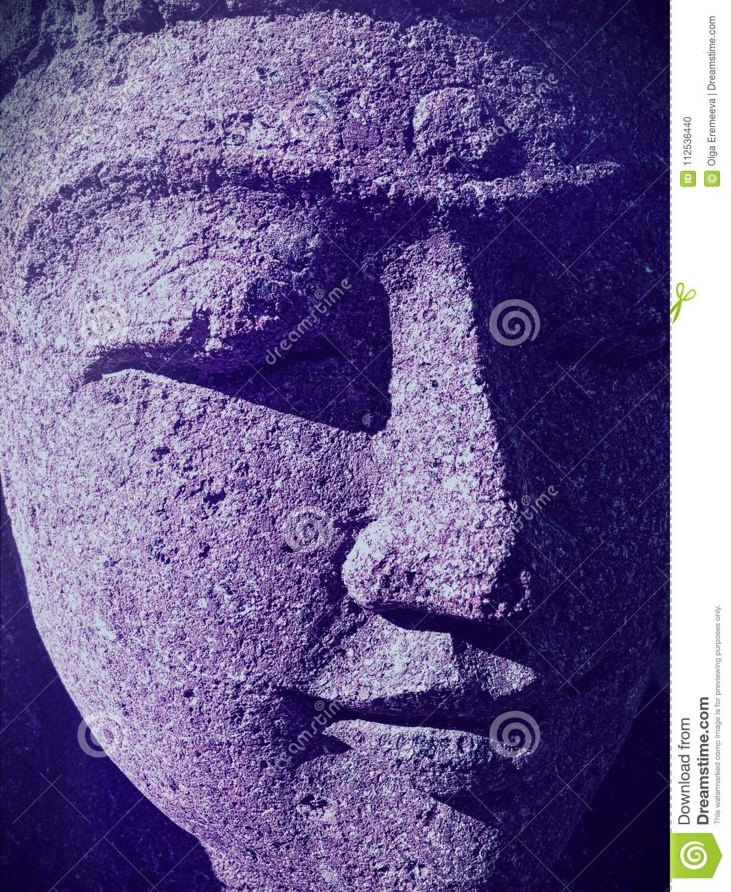 Closeup of Indian woman statue face with closed eyes and ultraviolet shadows