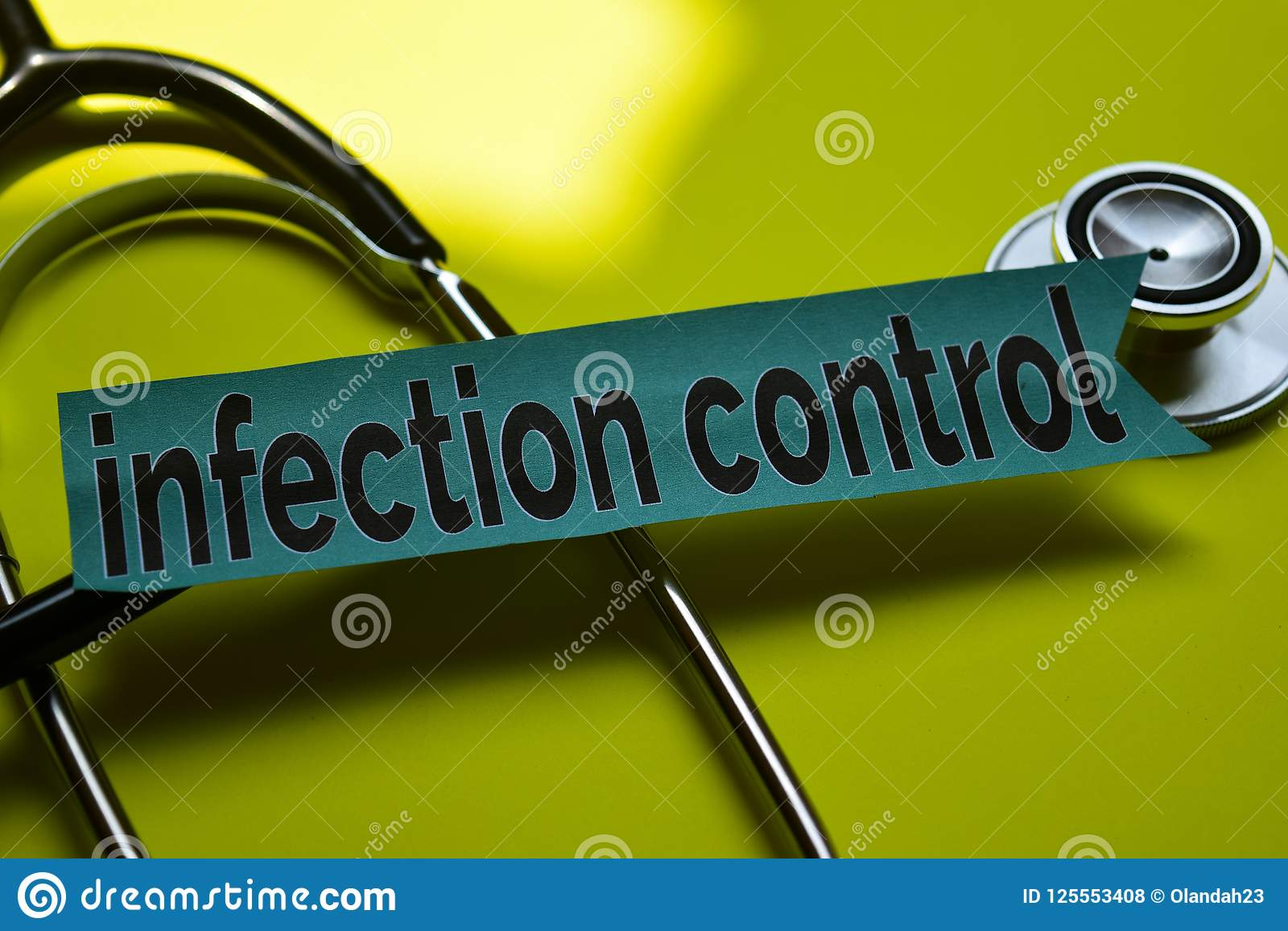 Closeup infection control with stethoscope concept inspiration on yellow background