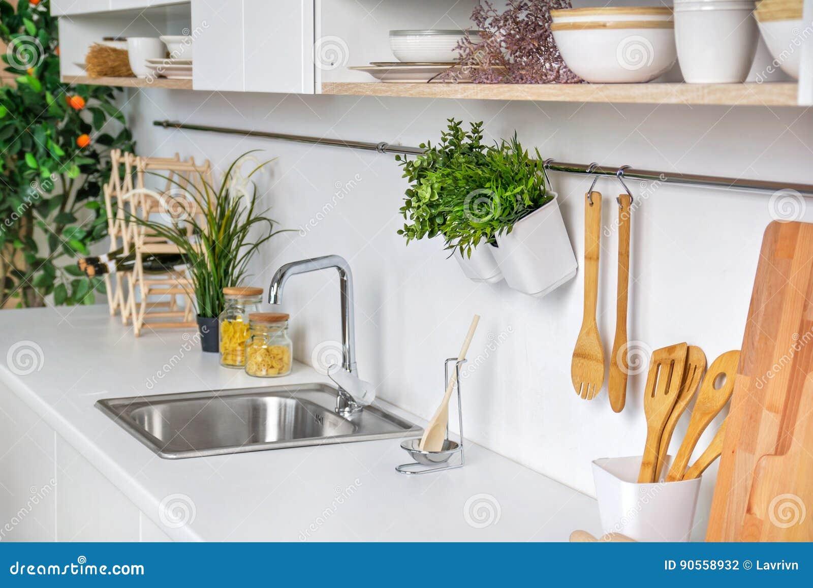 Closeup Of Interior Of Modern White Kitchen With Wooden Kitchenware ...