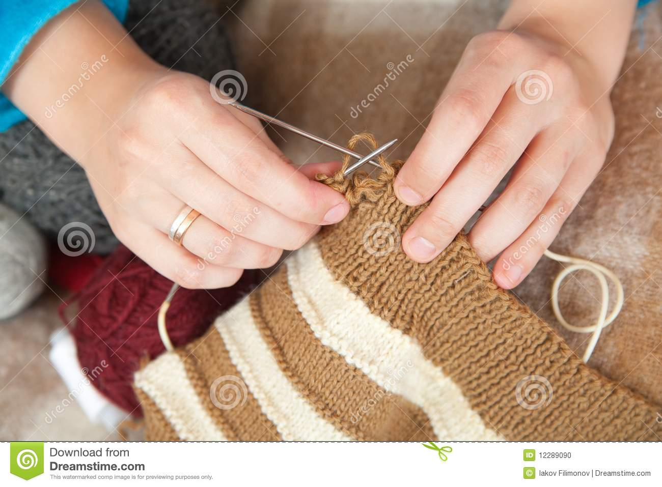 Knitting With Hands Only : Closeup of knitting woman hands stock photo image