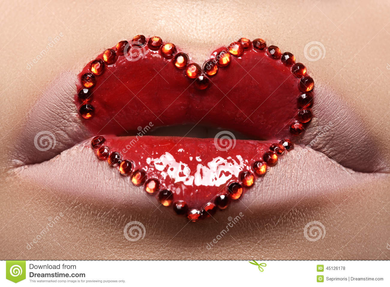 Closeup lips with red heart make-up & rhinestones. Valentines Day style