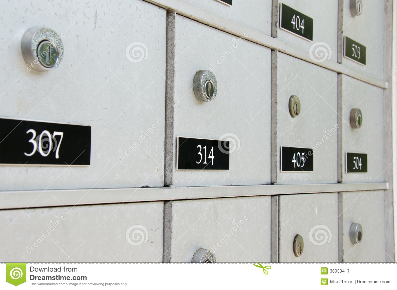 Closeup Of Locked Metal Apartment Mailboxes Royalty Free Stock ...