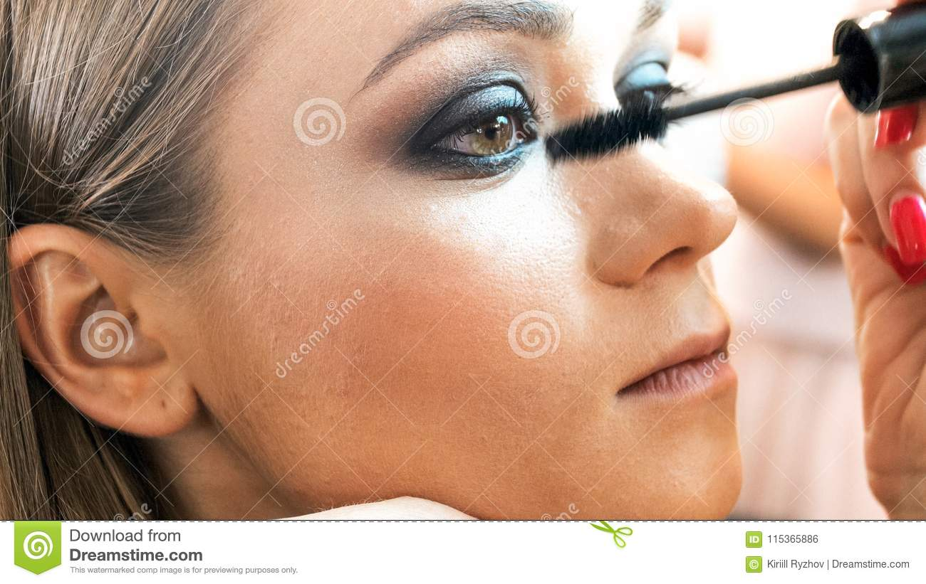 Closeup Image Of Makeup Artist Applying Smokey Eyes Makeup Stock