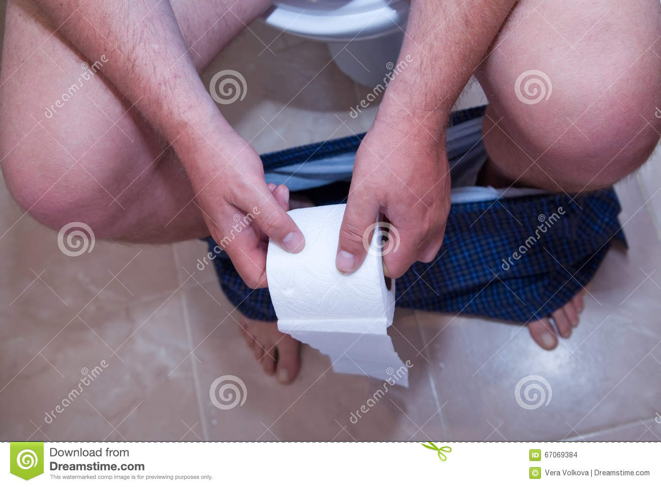 Closeup Of Male Body Parts While Sitting On The Toilet Stock Photo ...