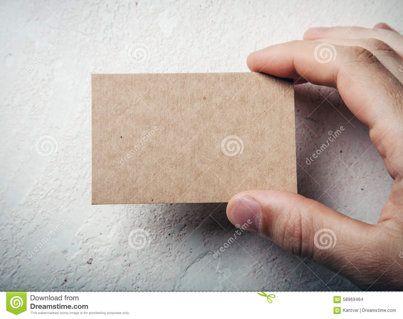 Closeup Of Male Hand Holding Craft Business Card Stock Photo ...