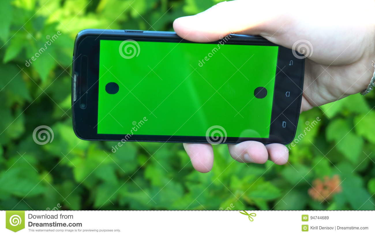 Closeup Of Male Hands Holding Smartphone With Green Screen