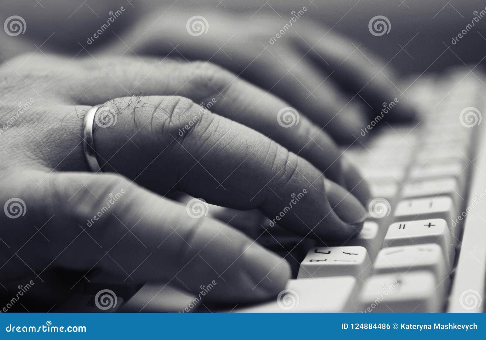 Closeup of man hands on computer keyboard