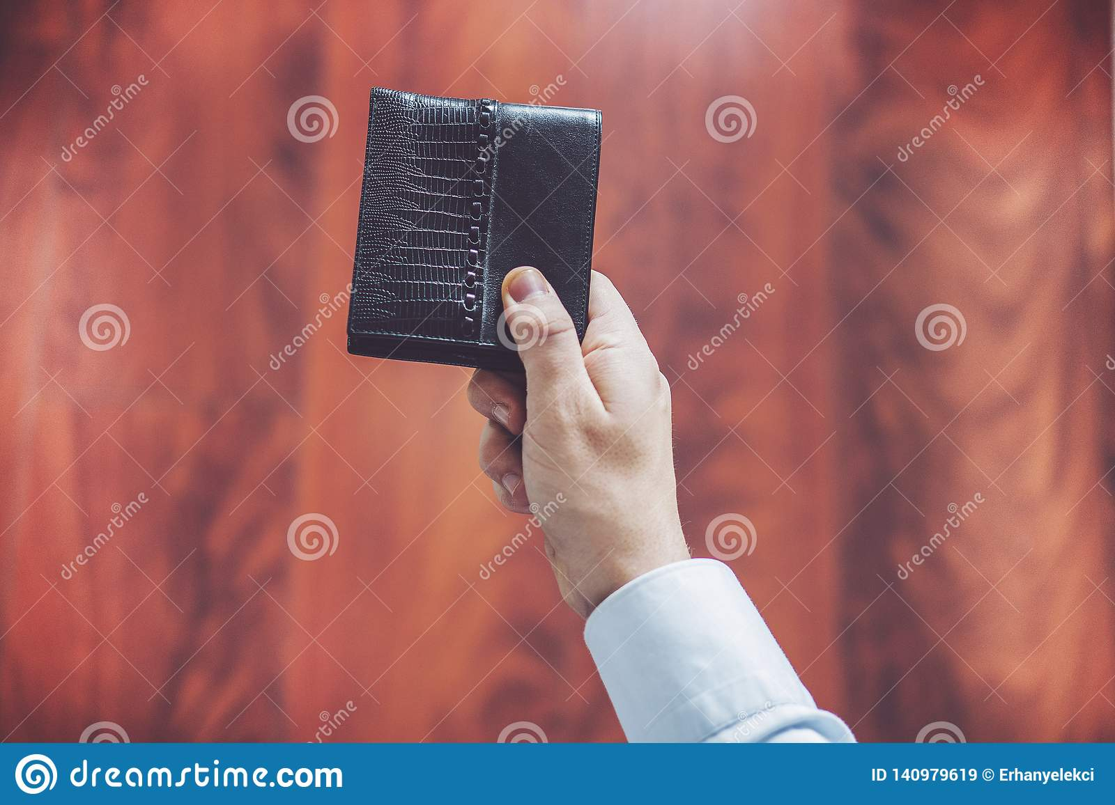 Closeup of man hands, man holds out wallet in hand