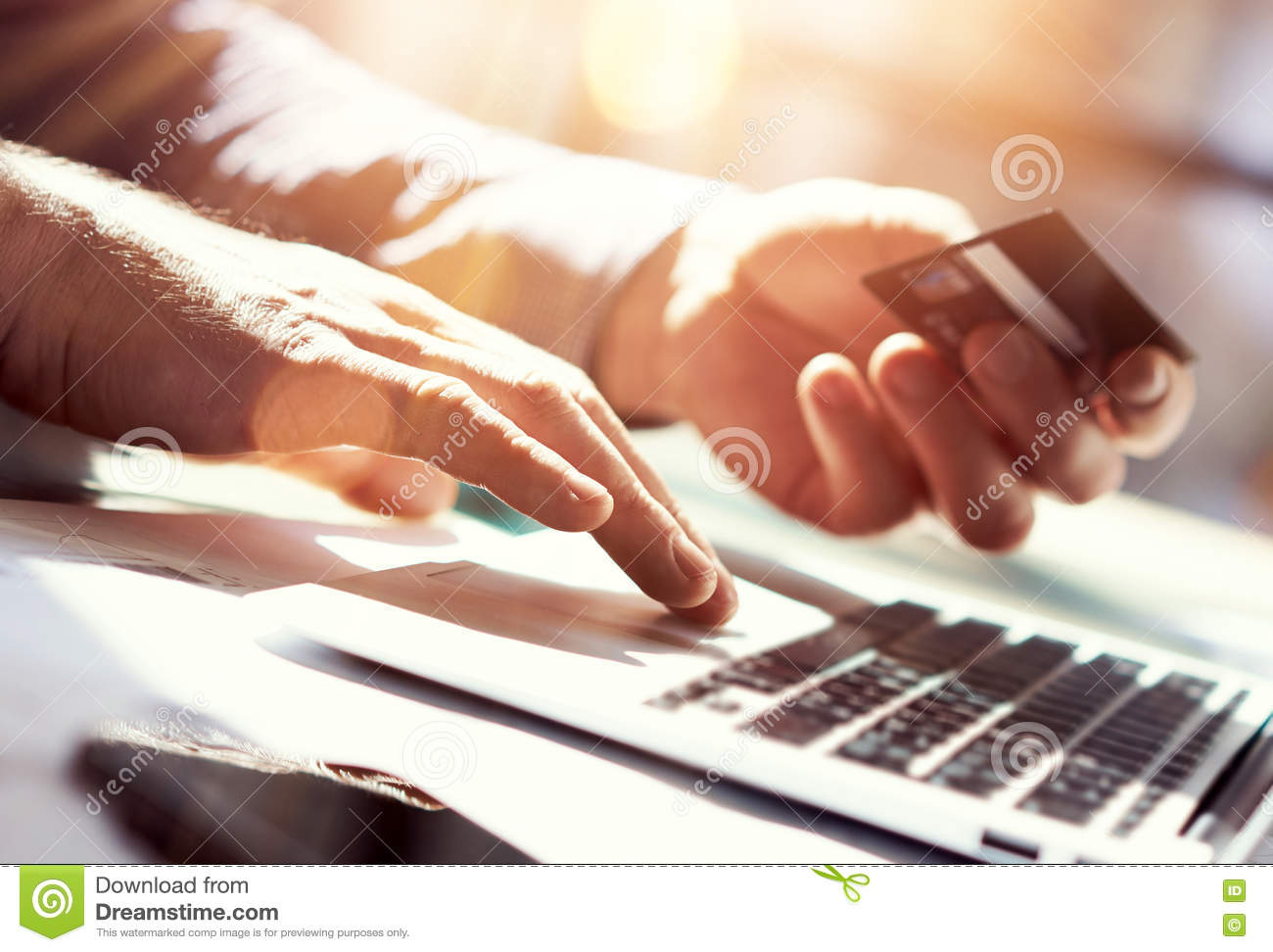closeup-man-holding-hand-credit-card-businessman-use-laptop-online-payments-shopping-guy-typing-keyboard-notebook-name-numbers-76810601.jpg