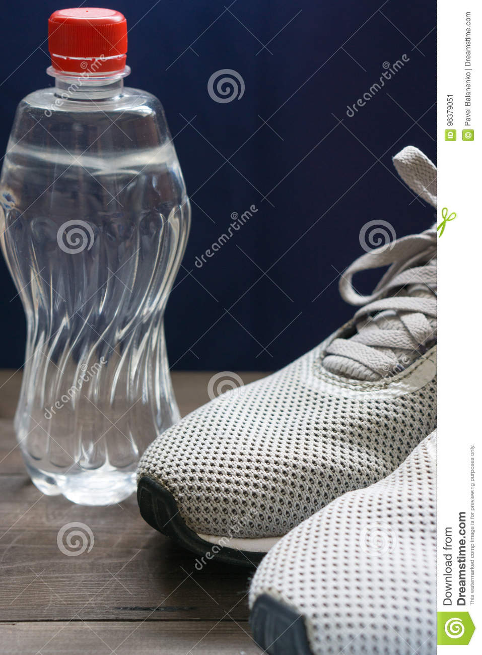 2fc97786fb502 Closeup Of Man& X27;s Sneakers With Water Bottle Stock Image - Image ...