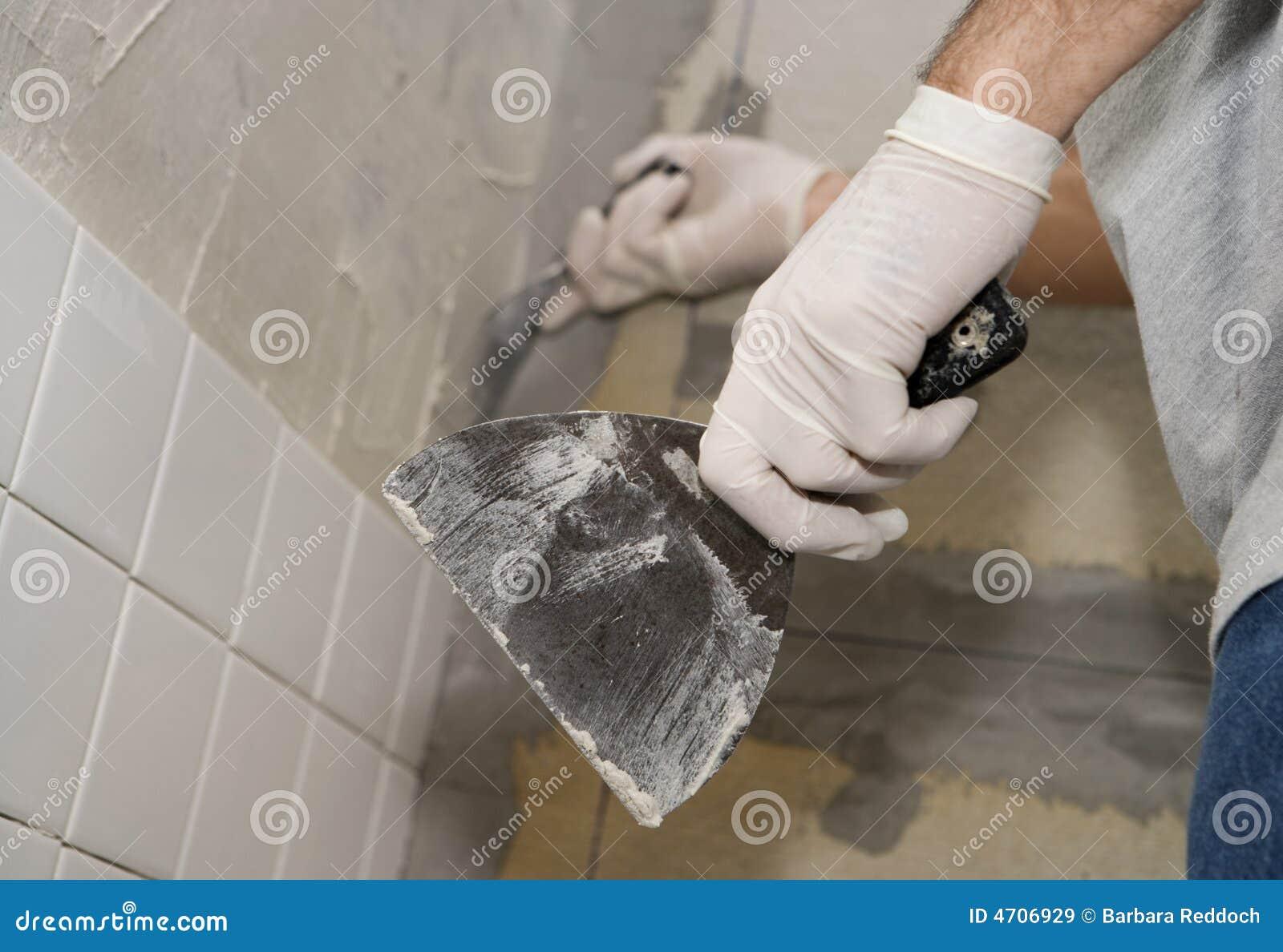 Closeup Of Man Tiling A Wall Stock Image - Image of selective, knife ...