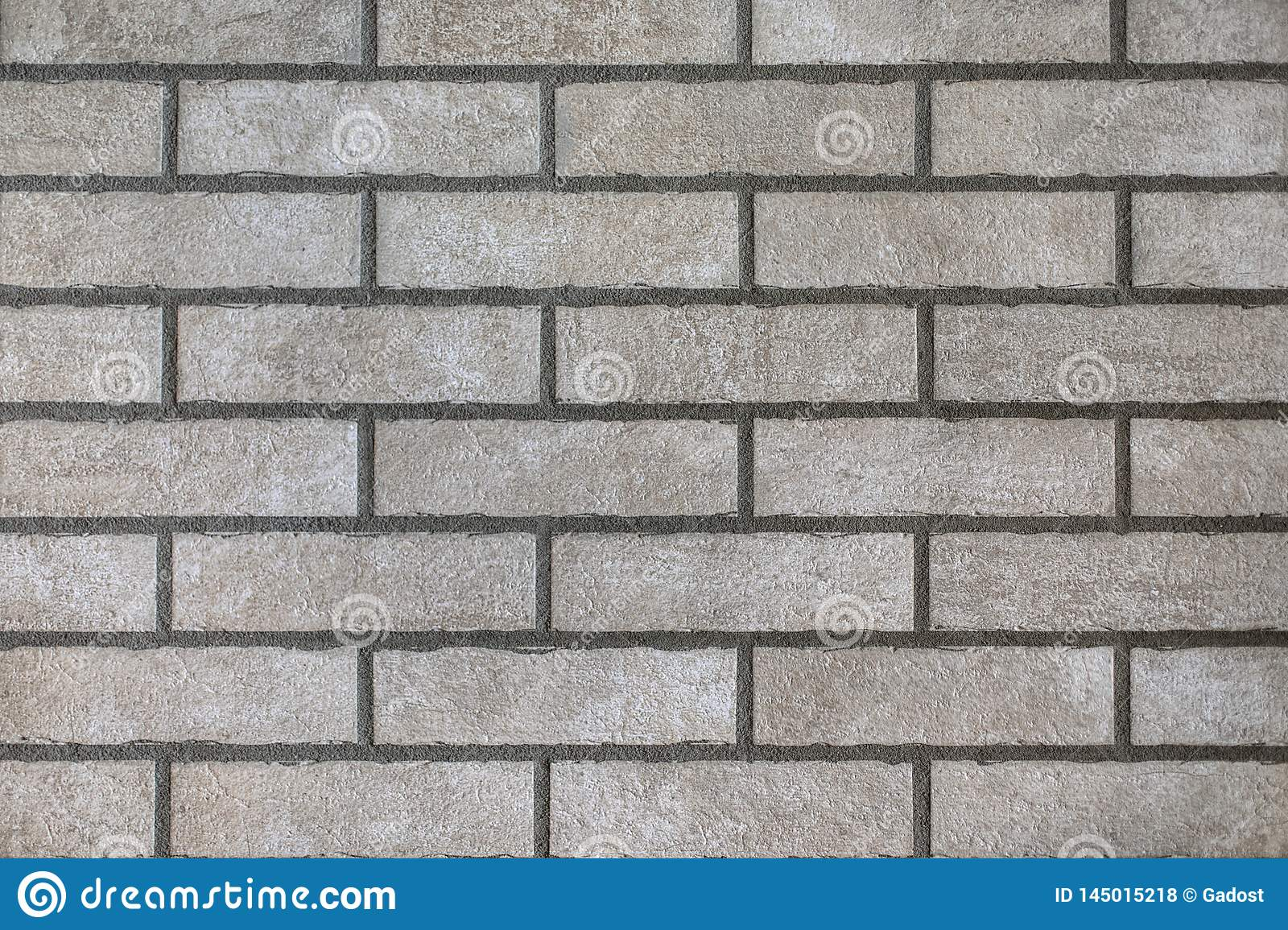 Closeup of modern neutral grey brick wall