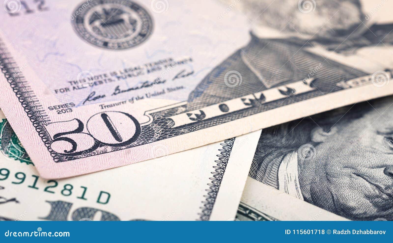 Closeup new American money fifty dollar bill. US 50 dollar banknote fragment macro
