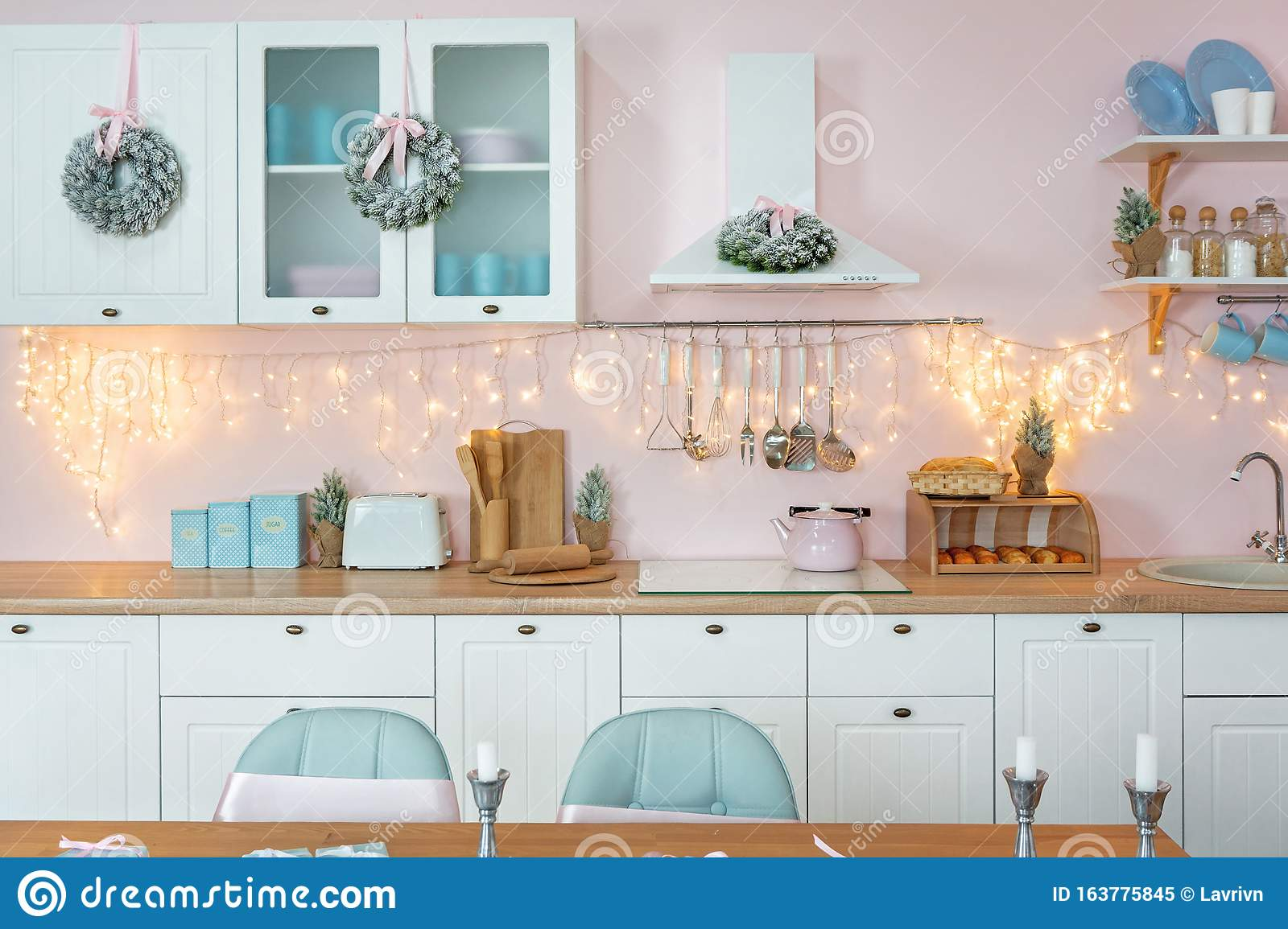 Closeup Of Interior Of Modern White Kitchen With Pink Walls And Blue Decor On A Christmas New Year Eve Stock Image Image Of Home Garland 163775845