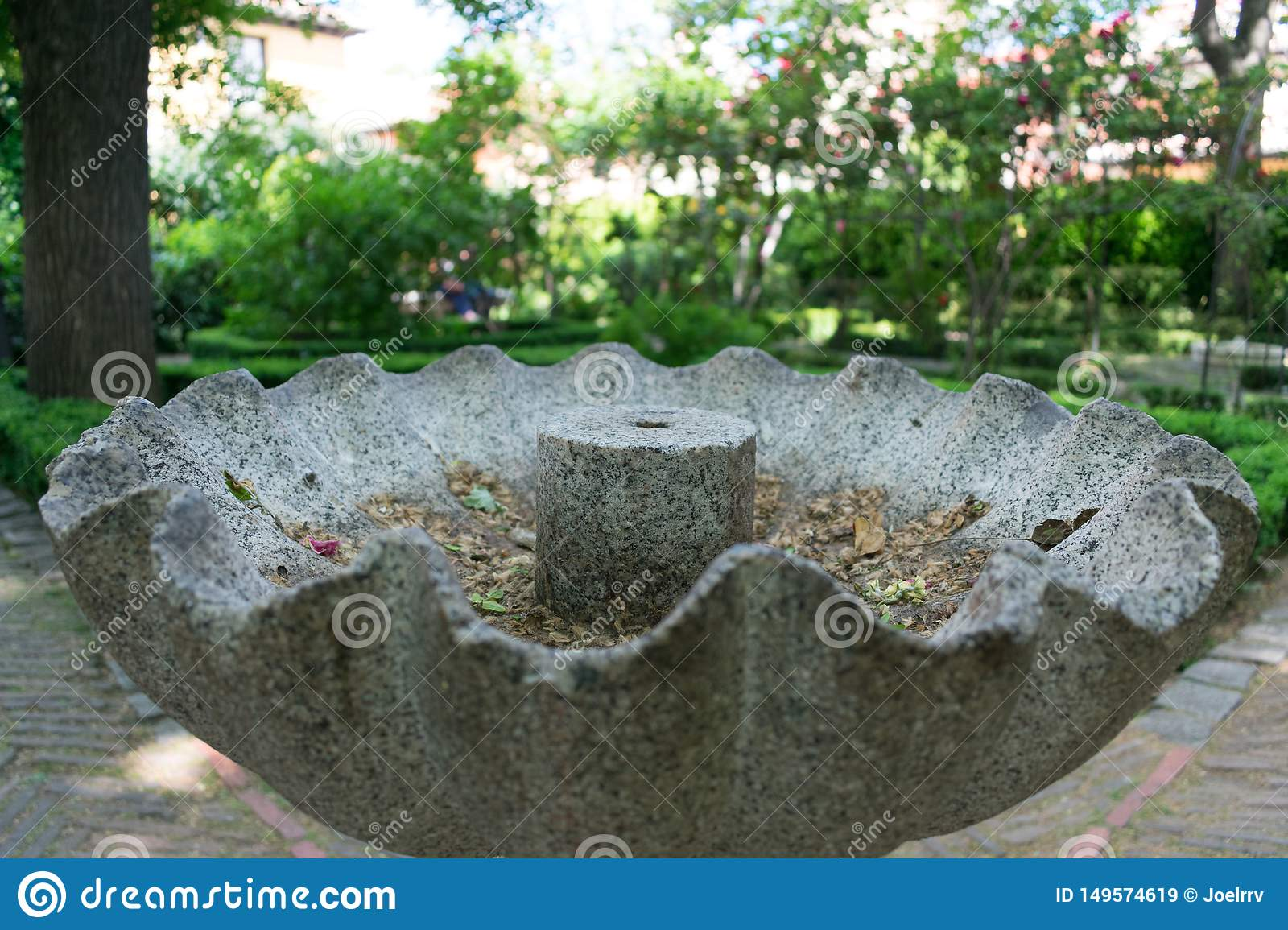 Closeup of old gray stone fountain in park