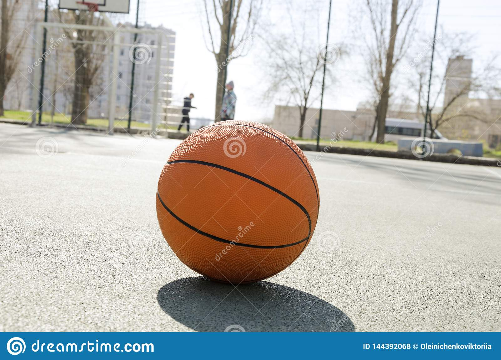 Closeup of orange ball for basketball on the rubber sport court.Sport ground outdoor in the yard