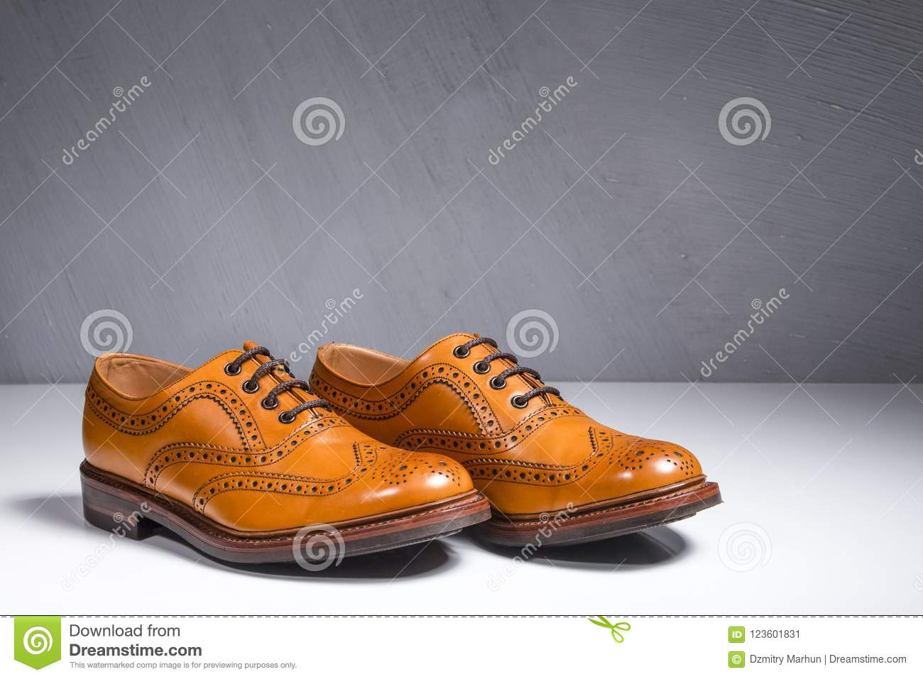Closeup of Pair of Luxury Male Full Broggued Tan Leather Oxfords