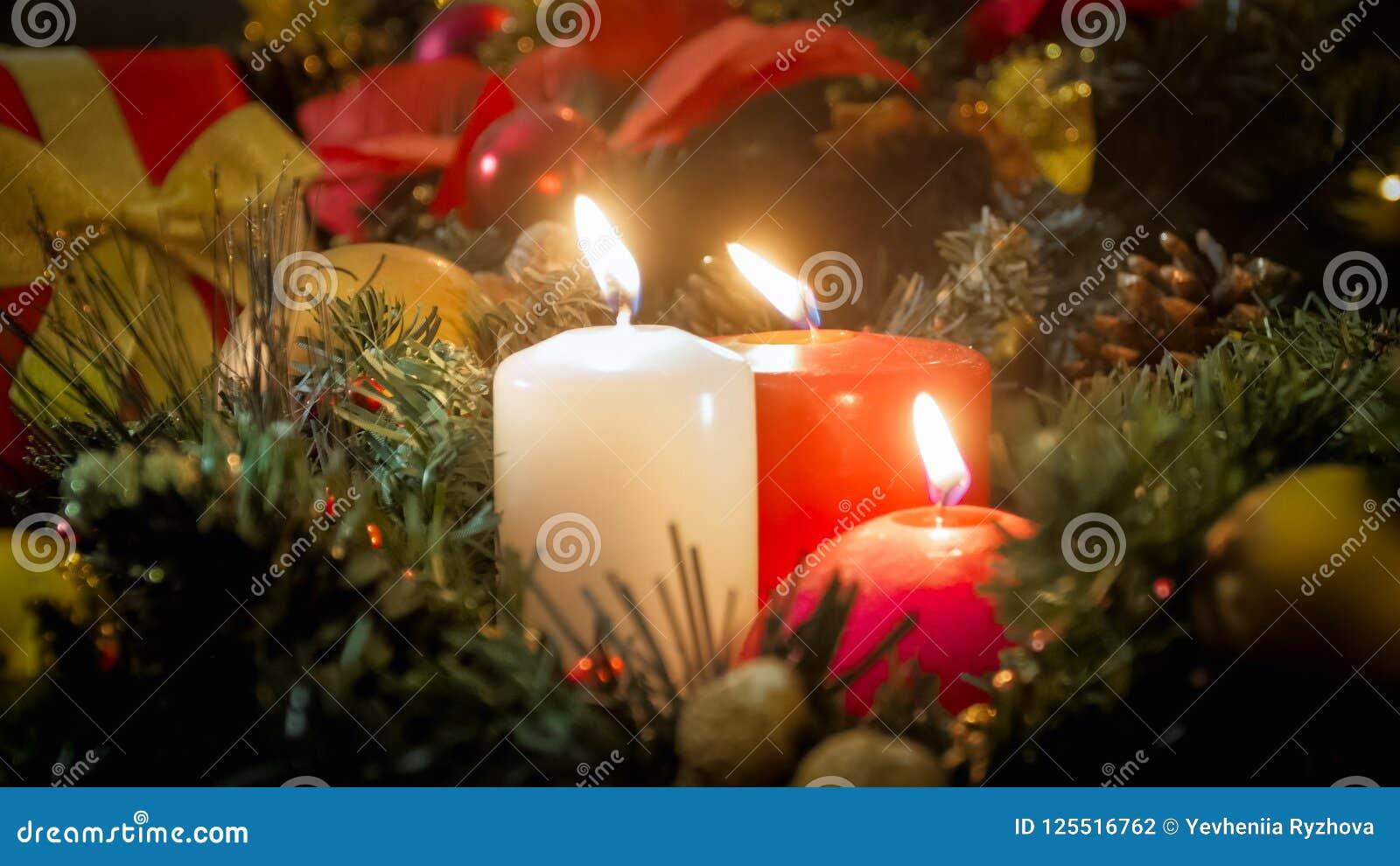 Beautiful Christmas.Closeup Image Of Three Burning Candles And Beautiful
