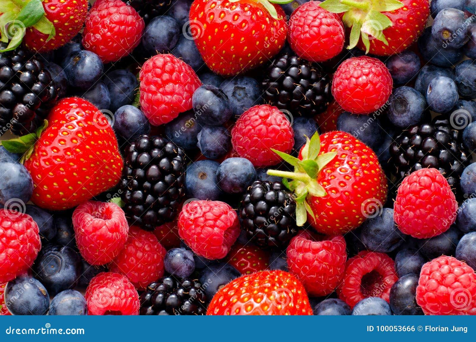 Closeup photo of wild berries strawberries, raspberries, blackberries, blueberries