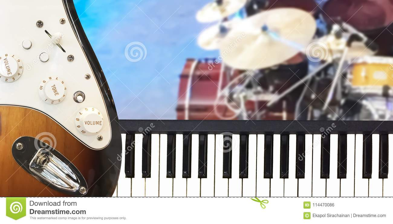 Closeup On Piano Keyboard And Electric Guitar Musical