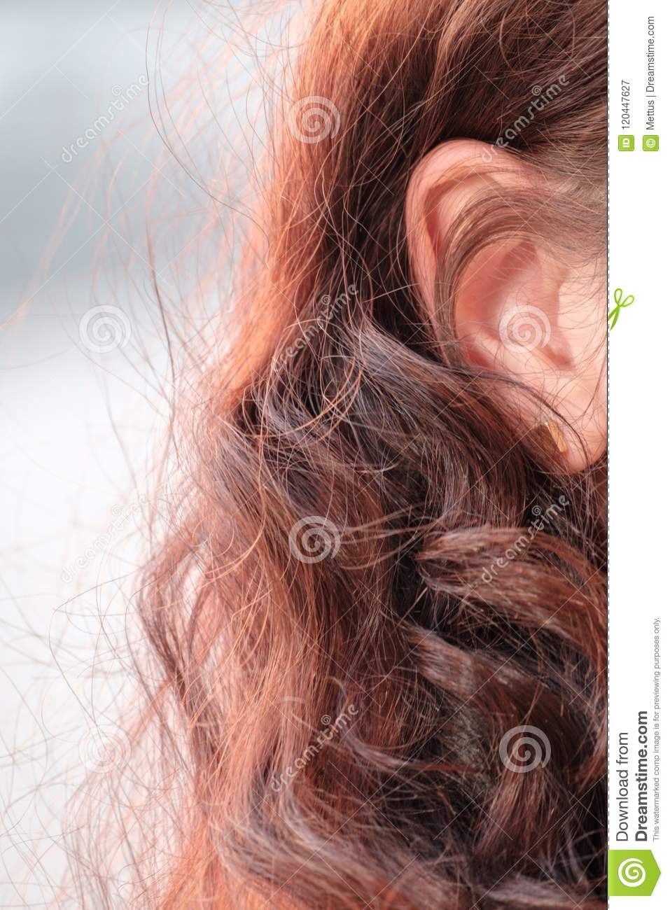 Closeup picture of redhaired girl ear