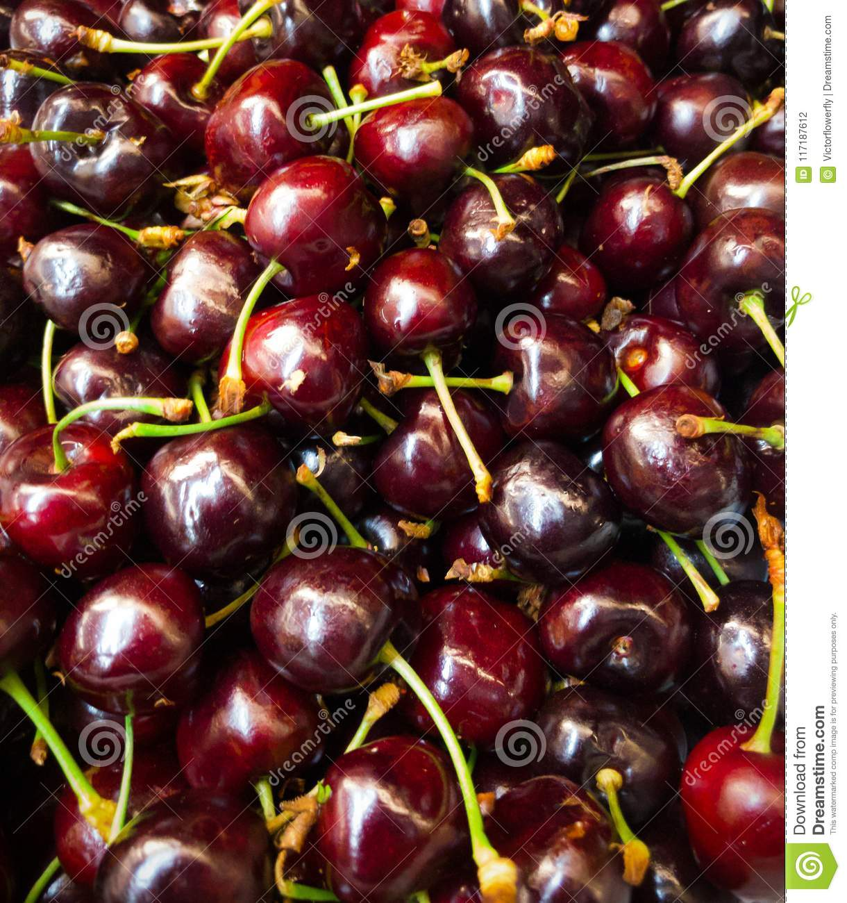 Closeup pile of natural fresh delicious red cherry fruit