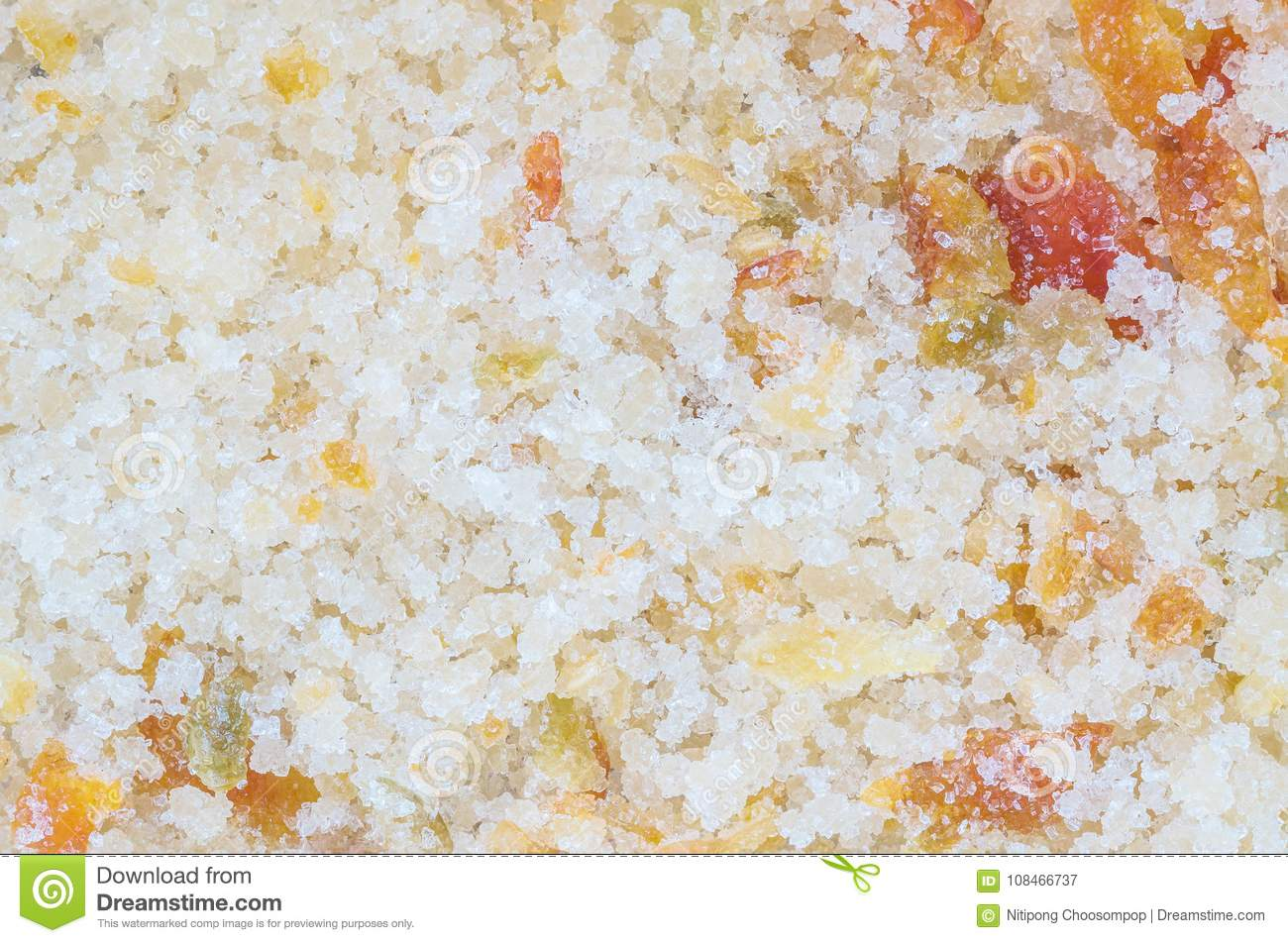 Closeup surface pile of sugar salt and ground red pepper for eaten as a condiment with sour fruit textured background