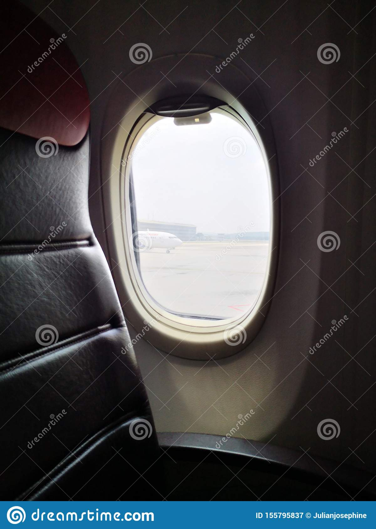 Closeup With Plane Seat Background Looking Through Window Stock