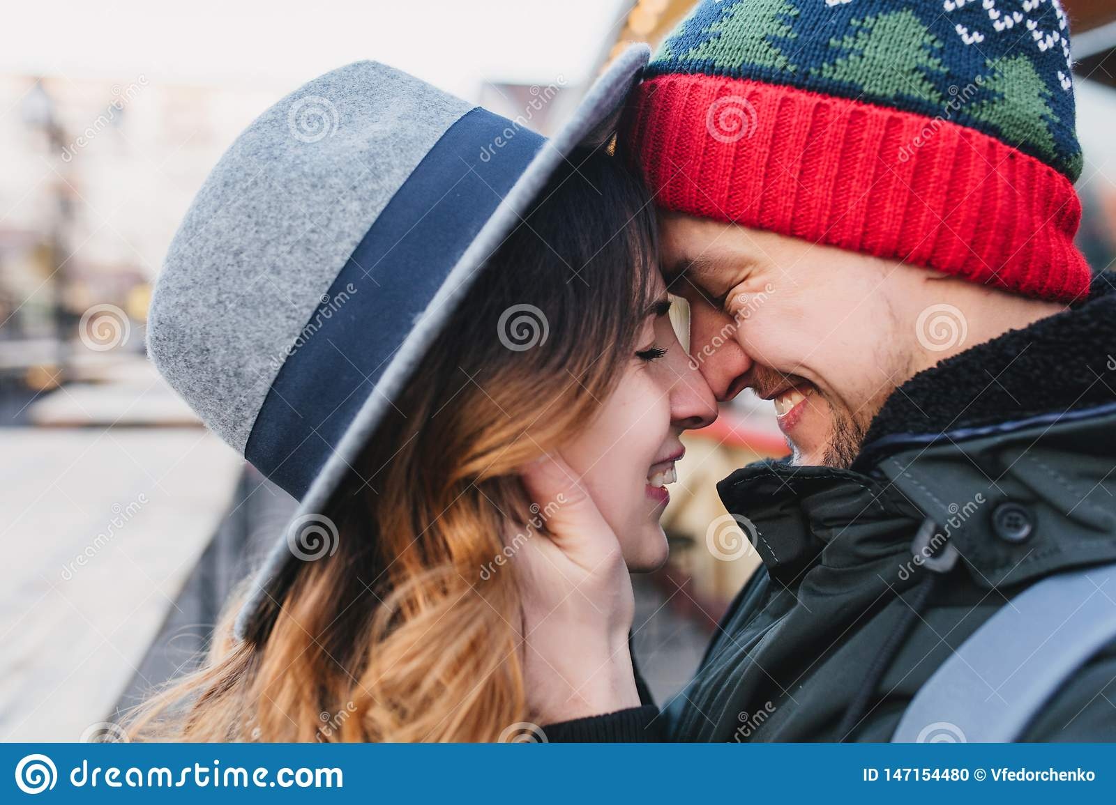 Closeup portrait amazing couple in love enjoying time together on street. True lovely emotions, brightful feelings
