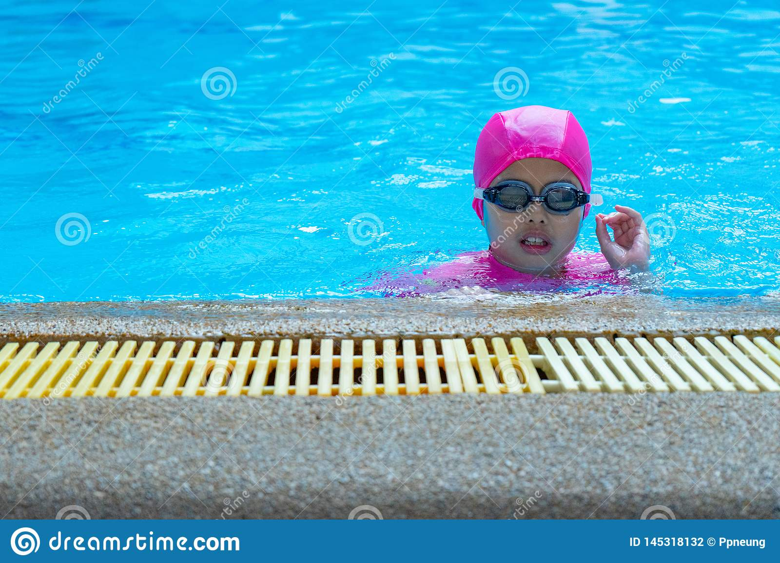 Closeup portrait Asian girl with swimming suite and eyeglasses in the pool