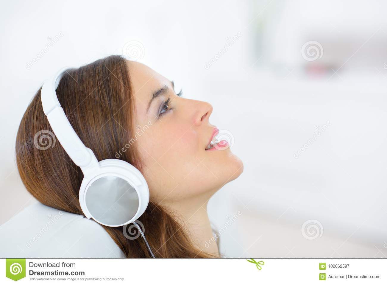 Closeup portrait attractive young female with headphones