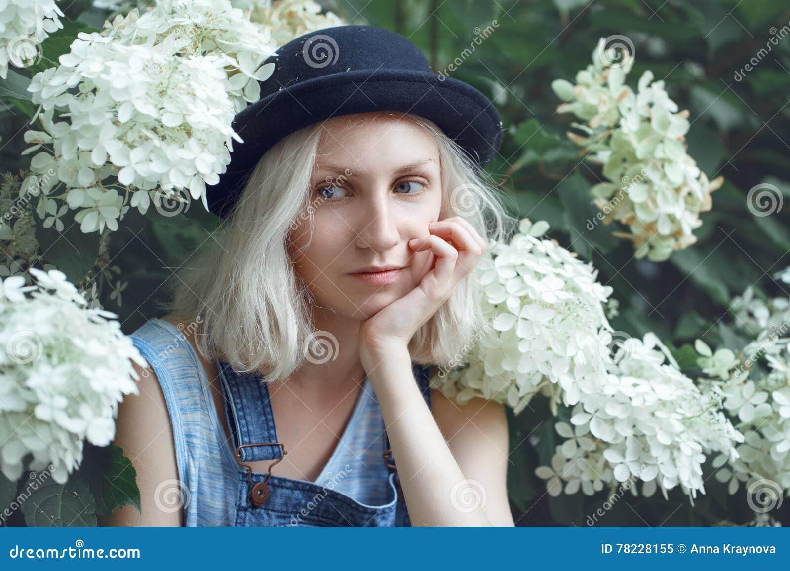 Closeup portrait of beautiful Caucasian teenage young blonde alternative model girl woman in blue tshirt
