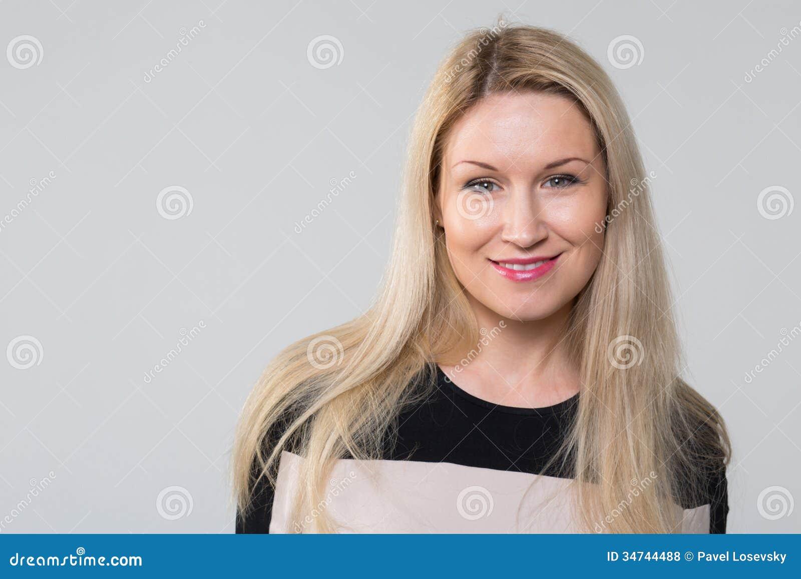 Closeup portrait of a beautiful smiling girl