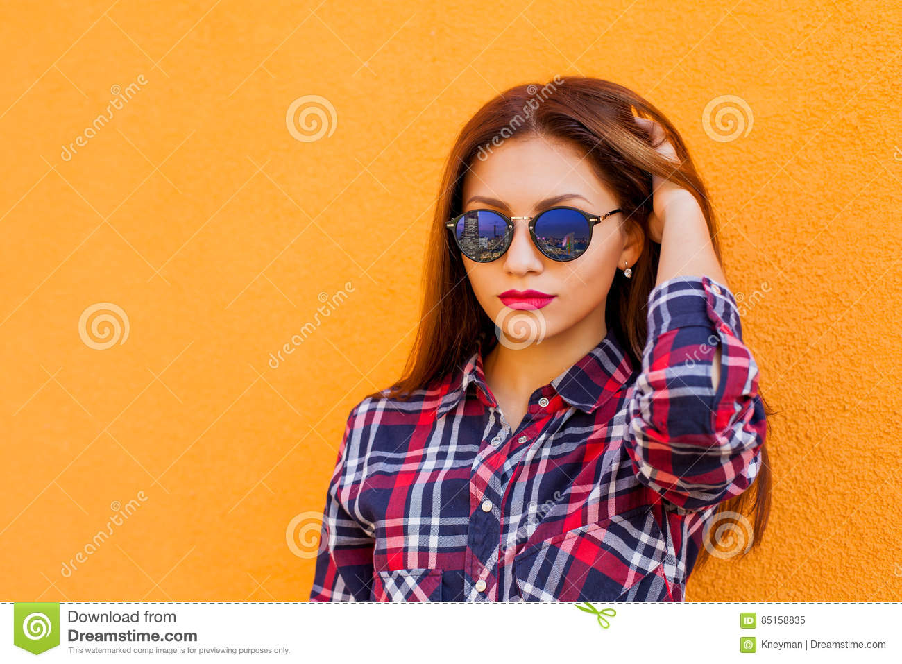 eba1ed799c Closeup portrait of beautiful woman with perfect make-up and sunglasses  with reflection