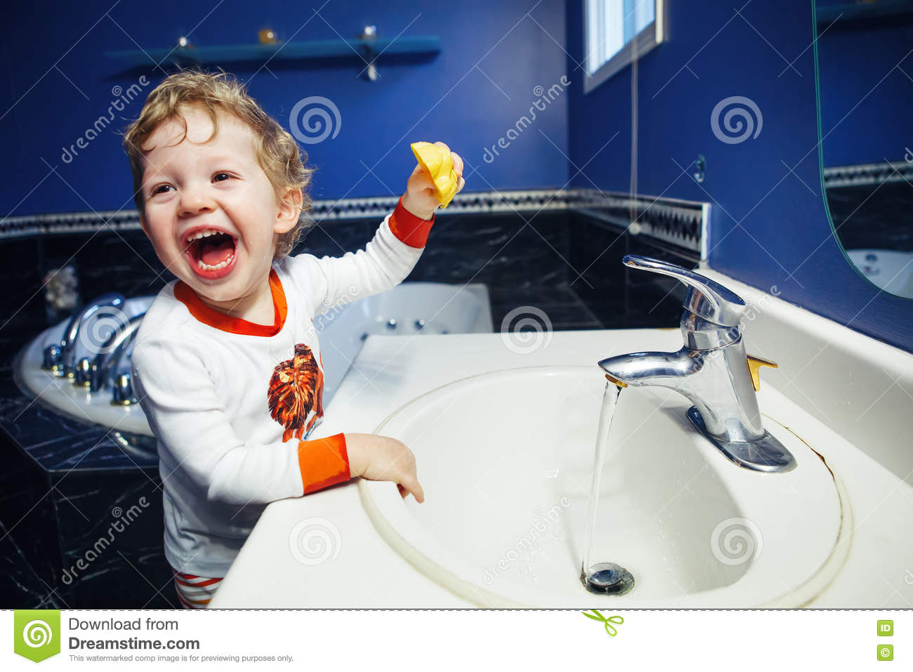 Closeup Portrait Of Child Kid Toddler Boy Girl In Bathroom Toilet Washing Face Hands Playing