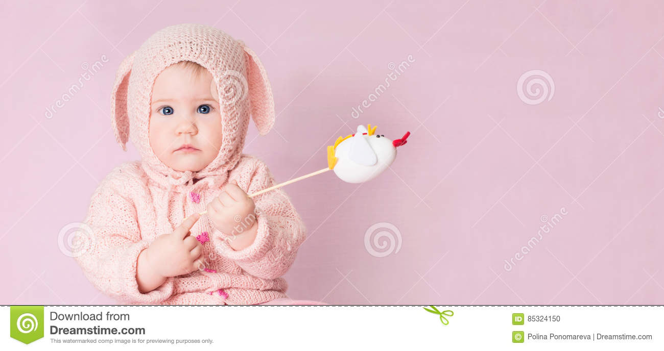 adbef6dd5 Closeup Portrait Of Cute Baby With Blue Eyes In Knitted Costume ...