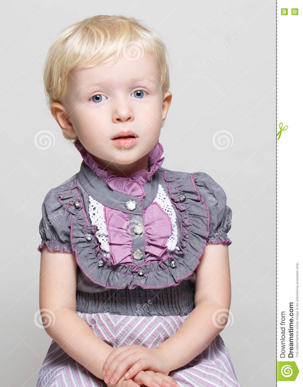 closeup portrait of cute child toddler with blonde hair and
