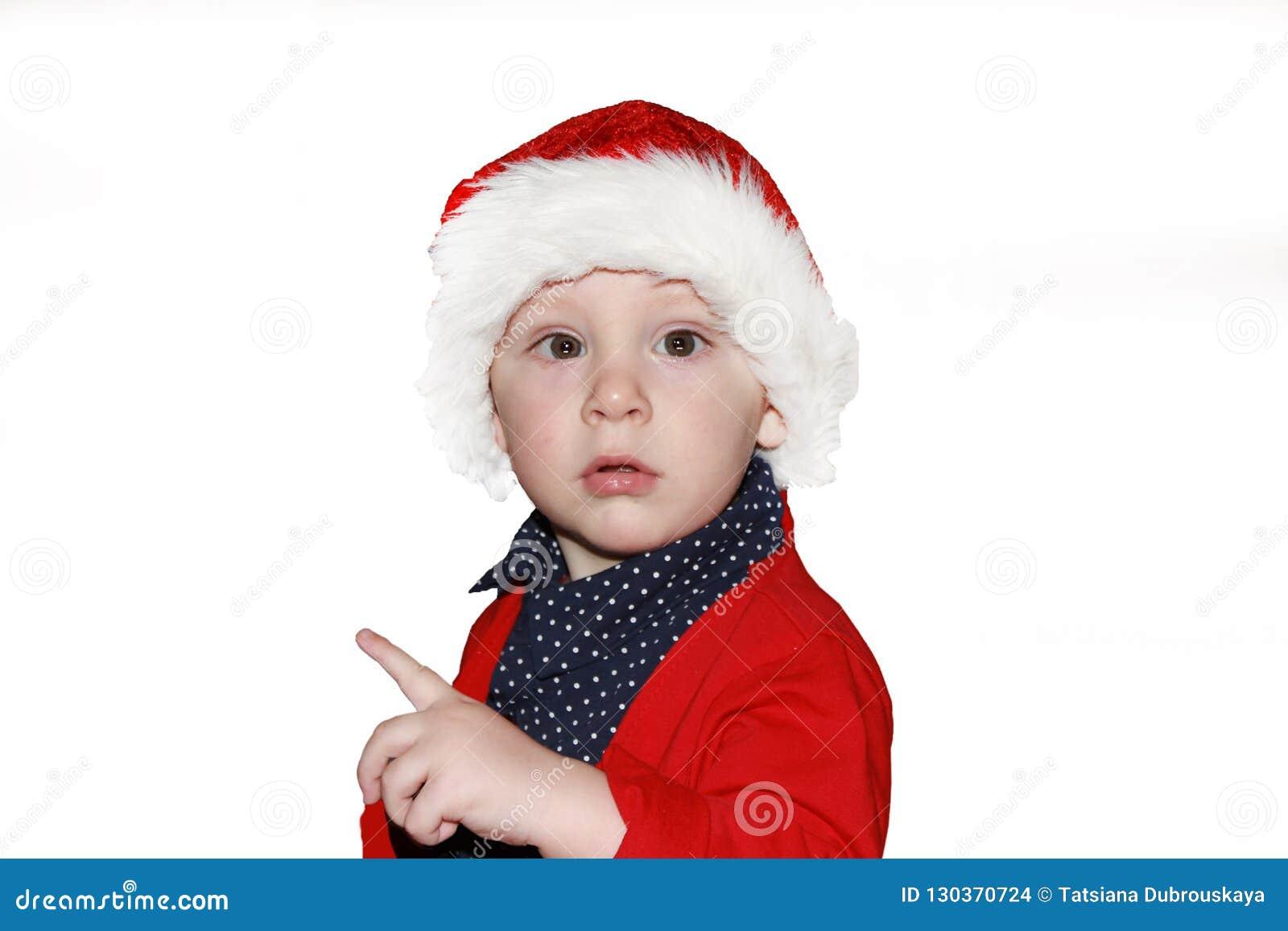 c8af0822e Closeup Portrait Of A Cute Little Baby Boy Wearing Red Santa Claus ...