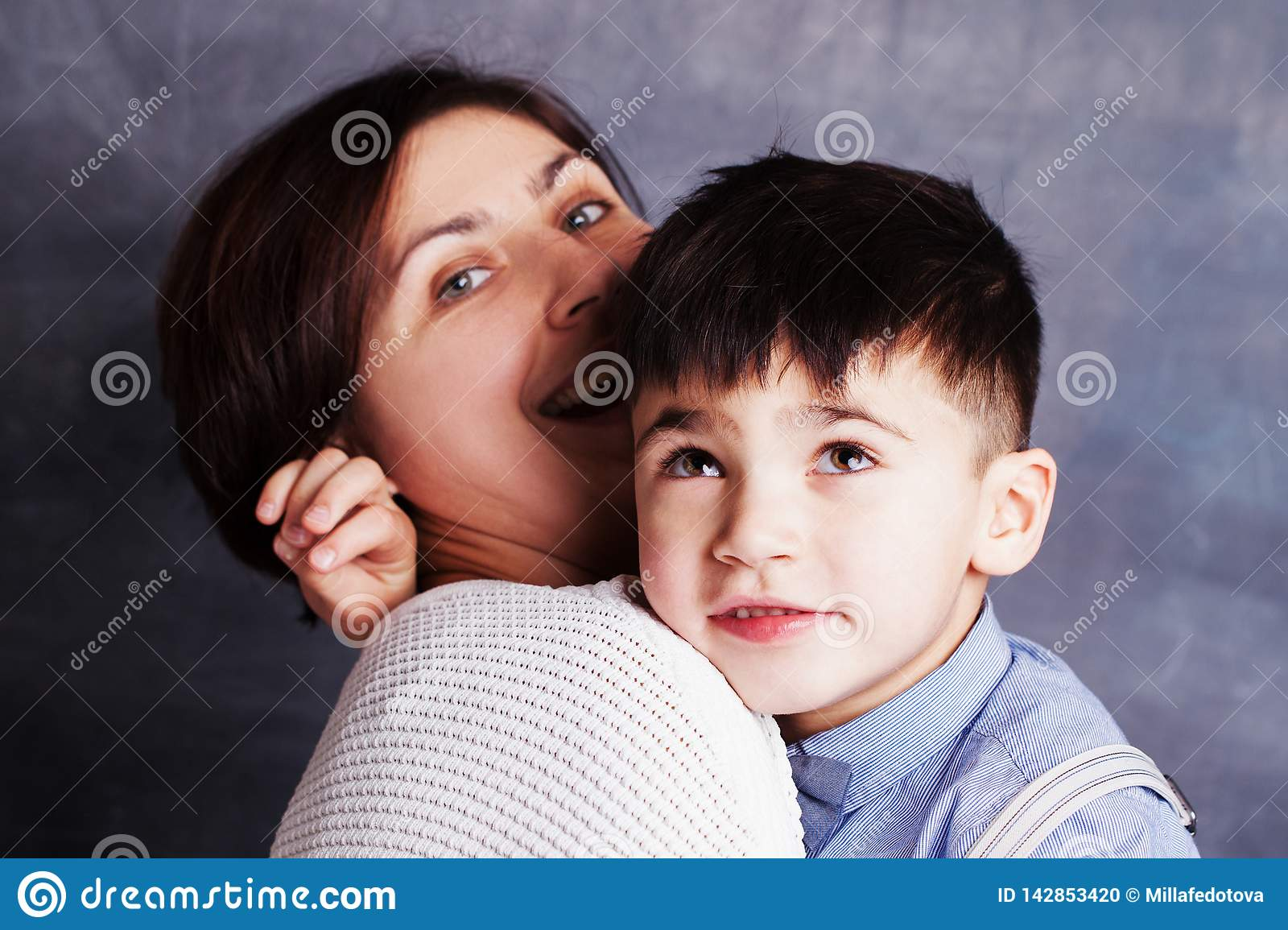 Closeup portrait of cute little boy and woman brunette. Mother and her son hugging
