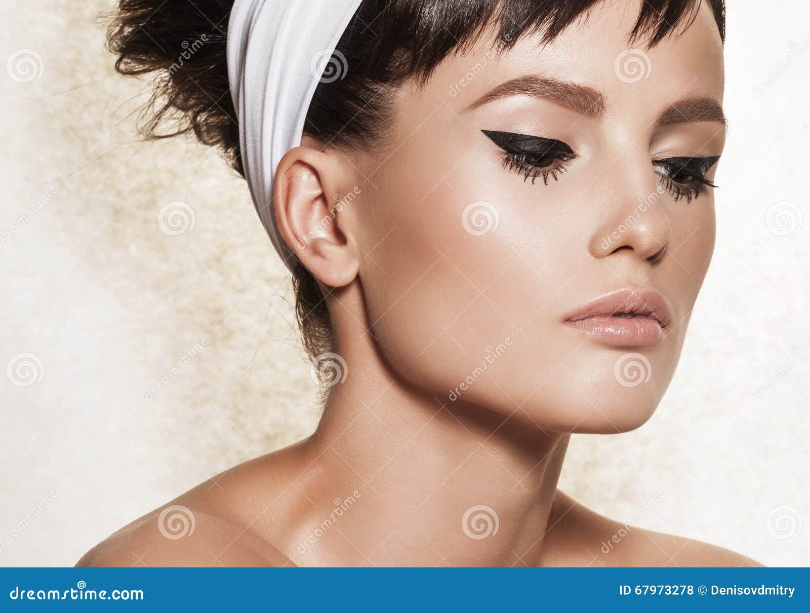 Closeup Portrait Of Elegant Woman With Retro Hairdo And Makeup Stock